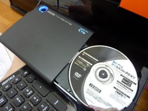 Discを入れて