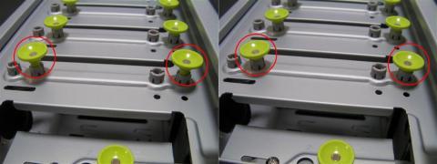 5インチベイは、黄色の金具を引く事でロックを解除、押し込むことで固定出来る。